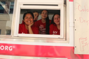 Girls Inc. girls serving coffee in their mobile coffee truck